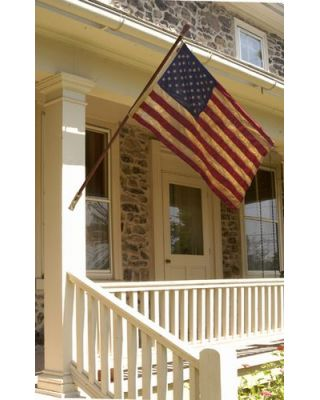 3ft. x 5ft. 50 Star Tea Stained US Flag Displayed on a House
